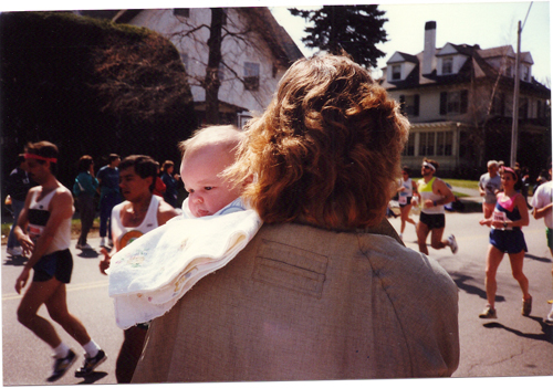 At mile 20 of the 1990 Boston Marathon, my Mom holds me as she watches for my Dad to run by.